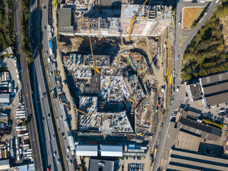 Aerial top view of construction site with cranes