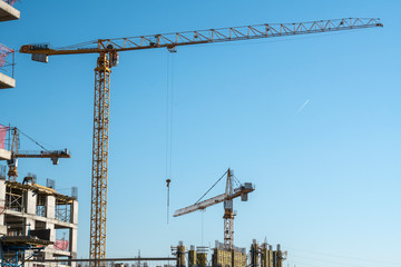 Crane on construction site with construction background