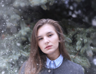 Young girl outdoors in winter. Model girl posing outdoors on a winter day. A festive weekend in the street walking girl.