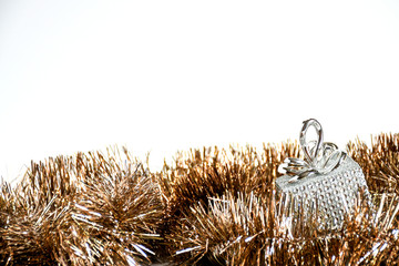 Close up gilter silver gift box and golden girland decoration christmas on isolated white background, Ornaments nature decor object, idea background for christmast and new year festival.
