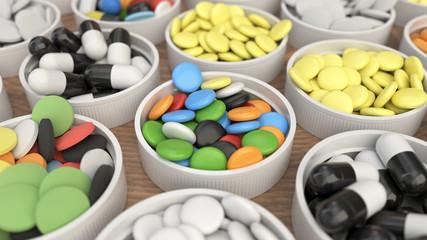 Colorful drug pills in lids