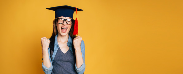 Study, education, university, college, graduate concept on banner. Happy and excited portrait of young student girl in hat of graduation isolated