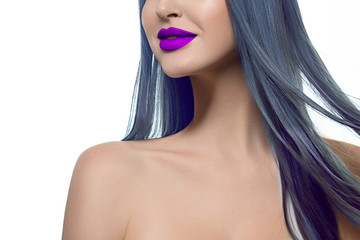 Close-up creative makeup image of sexy full lips and blue hair. Purple lip gloss on pale clear skin. Beauty dolls, cosmetological skin care, beauty salon, creative cosmetics