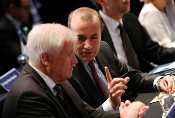 Manfred Weber, top candidate of Germany's Christian Social Union (CSU) for the European Parliament election, sits next to German Federal Interior Minister Horst Seehofer and leader of the Christian Social Union (CSU) at a party congress in Munich