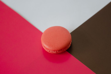 Pink macaroon is on the pink-brown background.