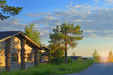 Log house in northern forest in evening on sunset, Finland, Lapland