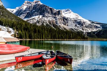 Conoes wait for passengers on Emerald Lake, Yoho National Park, British Columbia, Canada