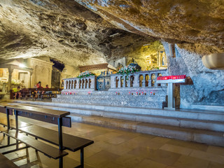 Apulia, Italy - Jul 17, 2018: Inside the shrine of the Sanctuary of San Michele Arcangelo, Monte Sant Angelo, an important pilgrimage site since the early Middle Ages