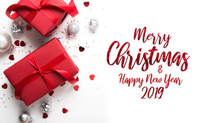 Merry Christmas and Happy Holidays greeting card. New Year. Valentine's day. Red gift, present on white background top view. Winter holidays.