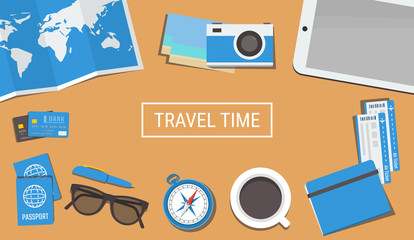 Traveler's desktop with a camera, plane tickets, passports, compass, a tablet, credit cards and a cup