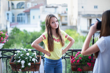 Two teen girls have fun and make selfie with the camera