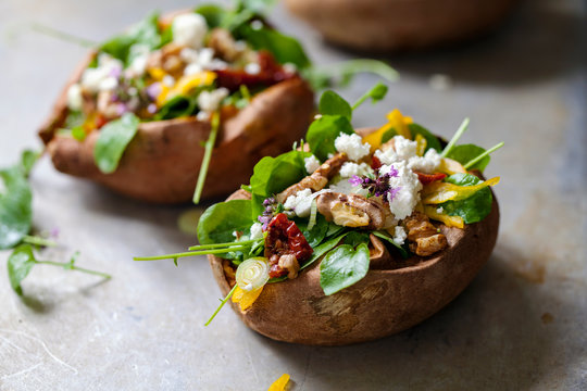 Baked sweet potato with salad