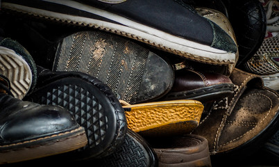 Close up of old dirty male shoes. Used shoes. Heap of old shoes. Many of dirty men shoe. Men shoes collection with not organized. Men keep shoe with disorderly. Men footwear.