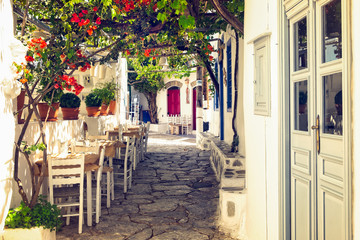 Fotobehang Smal steegje Traditional mediterranean colorful street on Amorgos island, Cyclades, Greece