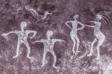 the image of ancient people on the wall of the cave, the history of antiquities archeology.