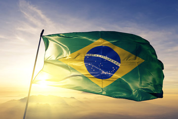 Foto op Plexiglas Brazilië Brazil brazilian flag textile cloth fabric waving on the top sunrise mist fog
