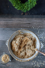 Rustic mixing bowl with peanut butter balls candy ingredients flat lay