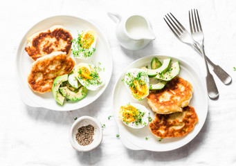 Served brunch table - potato scones and boiled eggs on a light background, top view. Delicious breakfast, snack, appetizer