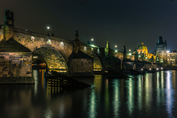 View of the Charles Bridge and Vltava river in Prague in a cold winter night - 2