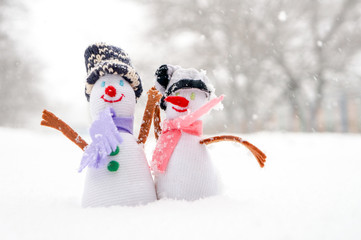 Snowman couple  in the snow