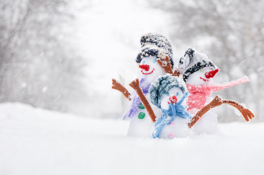 Snowman  family in the snow