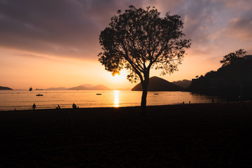 Silhouette of People on Sunset Beach at Repulse bay hong kong