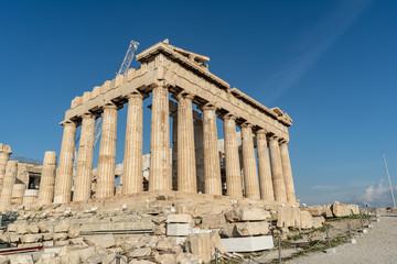 Morning view of the beautiful ancient monument, the Parthenon, with its ionic columns, in the Acropolis in Athens, Greece.