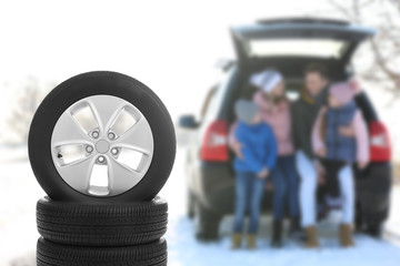 Winter tires and happy family on background, space for design. Car store service