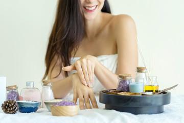 Woman applying moisturizing cream on hands. Lotion on the woman hand treatment in spa salon.