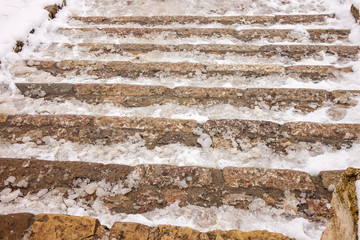 Old stone staircase in winter