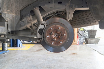 Repairing the car disk brakes in the garage.