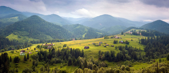 Fantastically beautiful morning in the Carpathians in the summer. amazing view of the mountain village Dzembronya foggy morning in the mountains in summer.