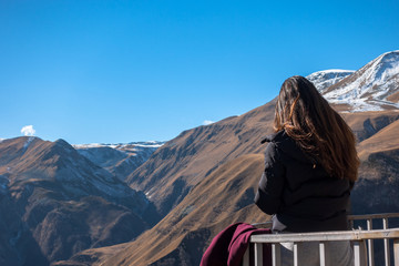 Silhouette of a girl on a background of mountains