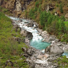 Turquoise colored river Dudh Kosi. Mount Everest National Park, Nepal.