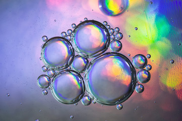 Photo textured holographic bubbles on colorful background