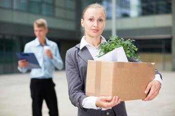 Businesswoman is standing happy near office