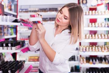 Girl choosing nail polish color