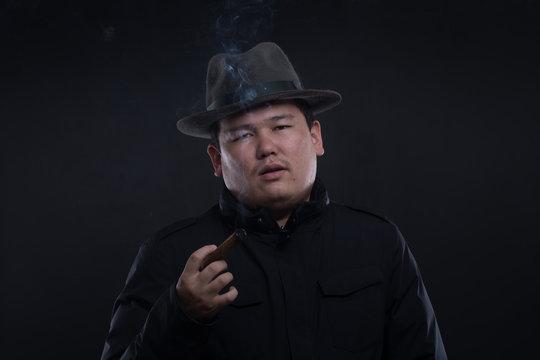 Asian man with a cigar