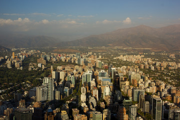View of Santiago de Chile with the Andes Mountains in the distance during the golden hour.