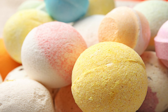 Many bath bombs as background, closeup view