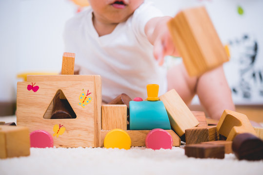 Asian child building playing toy blocks wood