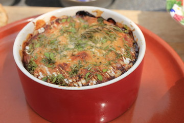 bowl with baked cheese