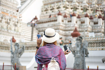 Visitors to Wat Arun are ancient temples built during the Ayutthaya period in Bangkok.