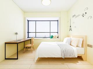 Yellow tones bedroom with simple desk
