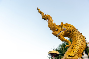the serpent Buddhism in Chiangrai temple north of Thailand with soft-focus and over light in the background