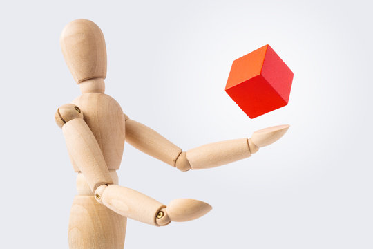 wooden mannequin with surreal wood cube