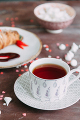 Croissants on a chic table with coffee and desserts. Food styling and layout with jam and berries.