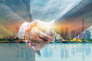 Businessmen are shaking hands for business venture and Marketing to invest in energy.