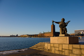 Statue and Town City Hall in Stockholm at the Riddarfjarden fjord on Riddarholmen island
