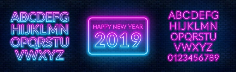 Fototapeta Neon sign happy new year on a dark background with bright alphabets.